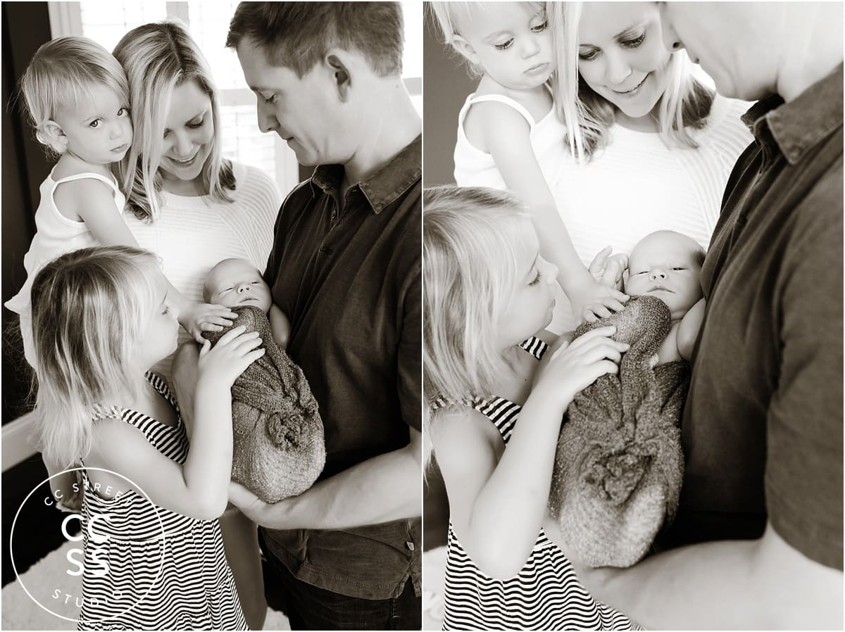 newborn with family photo
