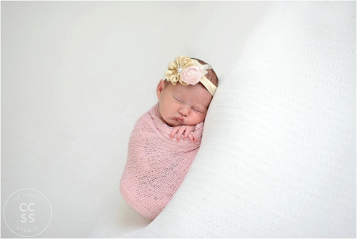 newborn-baby-in-pink-wrap